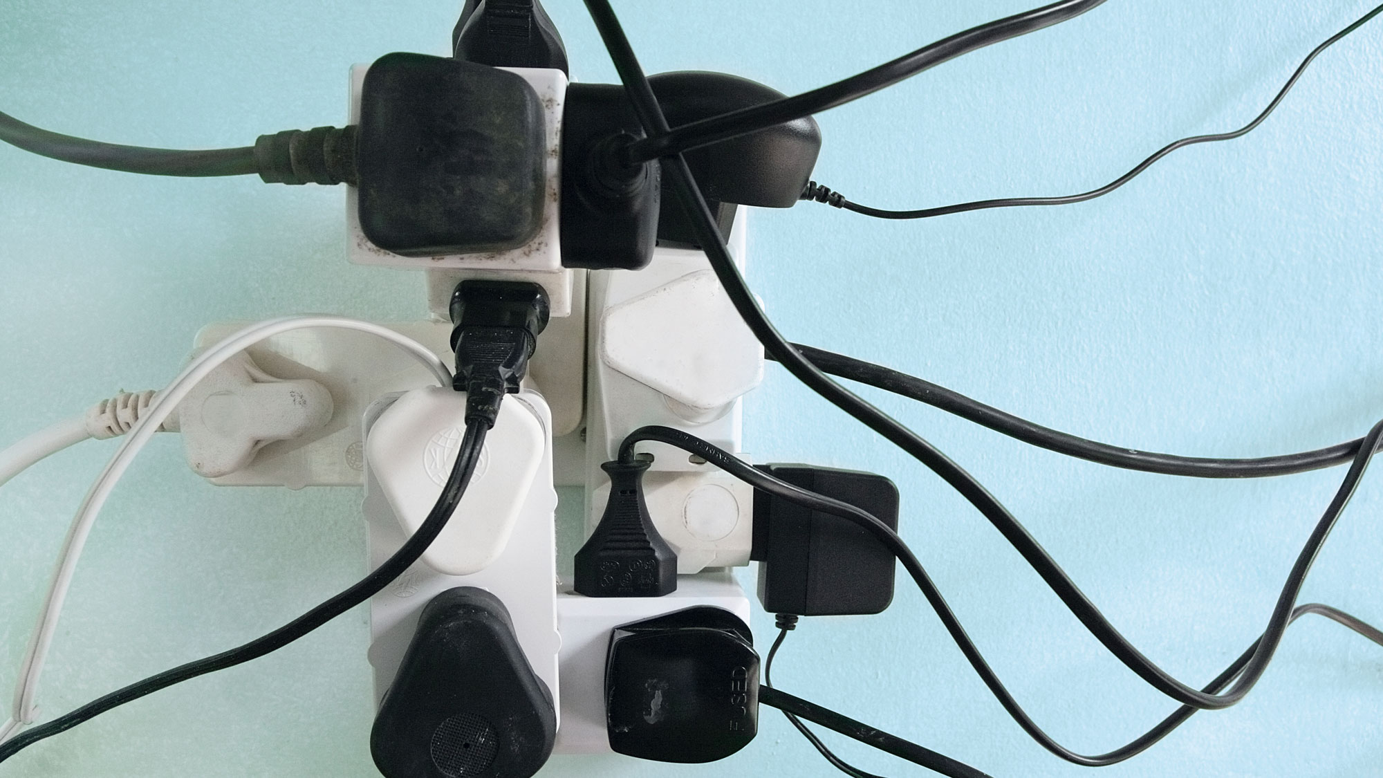 photo of wall outlet with too many plugs